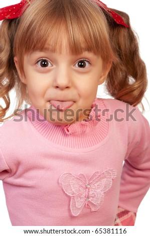 Little beautiful cheerful girl showing tongue - stock photo