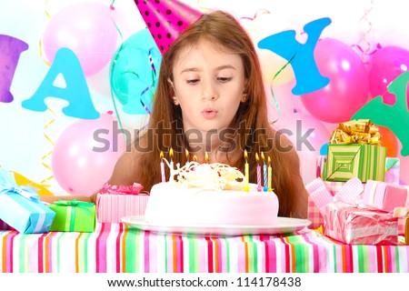 Little beautiful girl celebrate her birthday - stock photo
