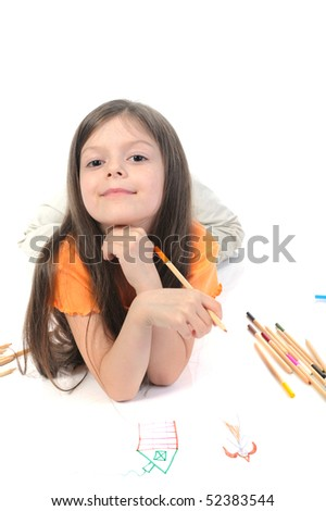 Little beautiful girl draws pencil on paper. Isolated on white background