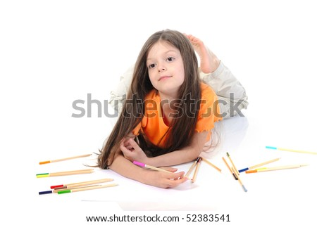 Little beautiful girl draws pencils. Isolated on white background
