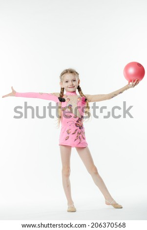 little beautiful girl gymnast doing exercises