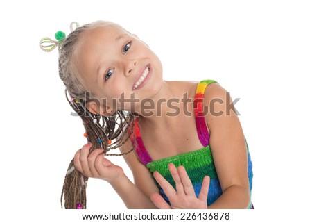 Little beautiful girl holding hands her dreadlocks. Girl is six years. - stock photo