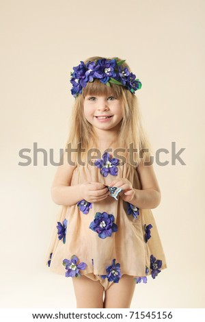Little beautiful girl in blue garland - stock photo