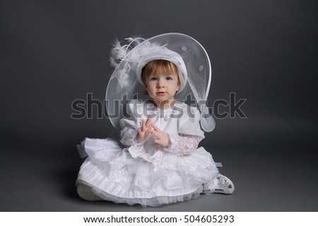 little beautiful girl in wedding dress