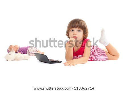 Little beautiful girl is playing with make-up over white background - stock photo