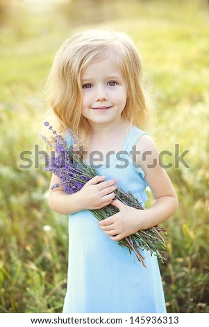 little beautiful girl smiling outdoors in summer
