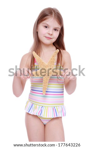 Little beautiful girl wearing pink swimsuit stock photo royalty little beautiful girl wearing pink swimsuit holding big sea star isolated on white background thecheapjerseys Gallery