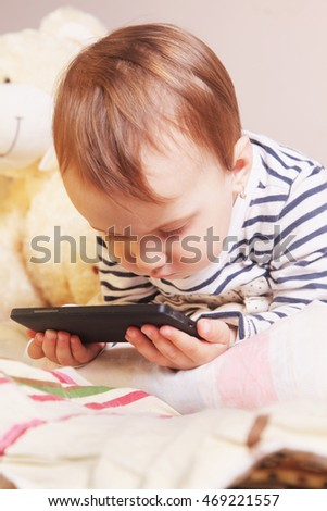 Little beautiful  girl with her smart phone