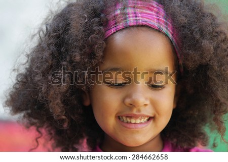 Little beautiful smiling girl  - stock photo