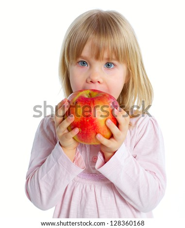 Little beauty girl eating big red apple. Isolated white background - stock photo