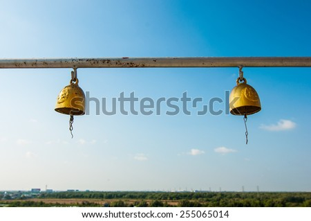 little bell at temple on blue sky background. - stock photo