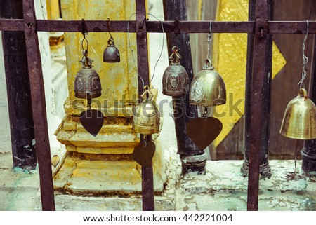 little bells with golden leafs hanging in a temple - stock photo