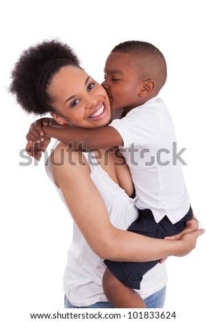 Little black boy kissing her mother, isolated on white background
