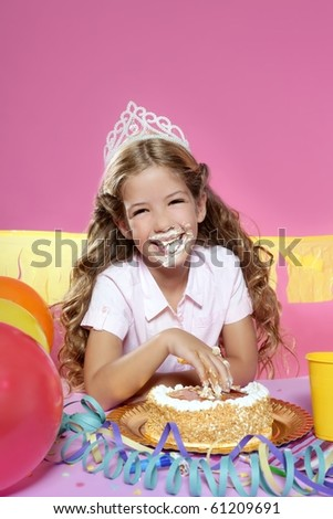 little blond birthday party girl eating cake with hands on pink background