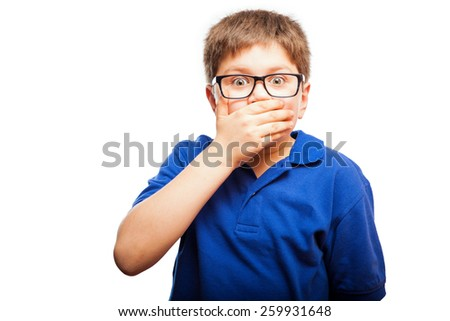 Little blond boy covering his mouth with a hand as a sign of shock and secrecy - stock photo