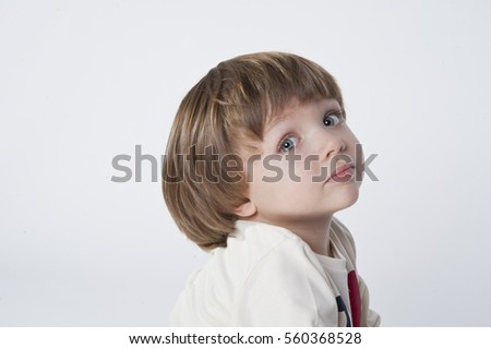 Little blond boy with blue eyes looking