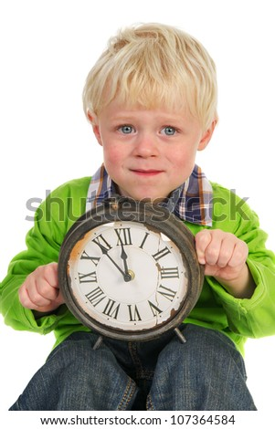 Little blond child with old clock five for twelve