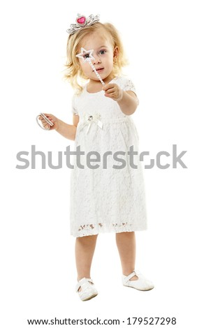 Little blond girl as a fairy princess, with magic wand and tiara, isolated on white background
