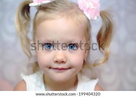 little blond girl expressive close up portrait - stock photo