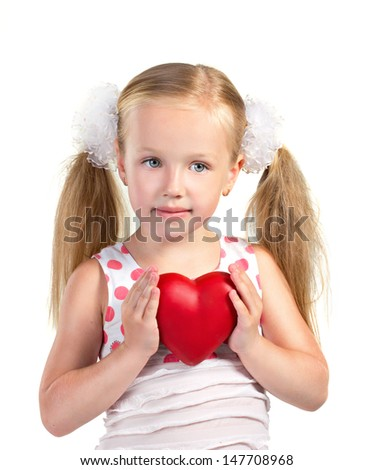 little blond girl holding a red heart on white background