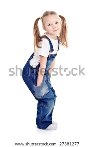 little blond girl in blue overalls holding hands in her pockets