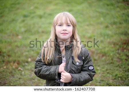 little blond girl in the autumn park