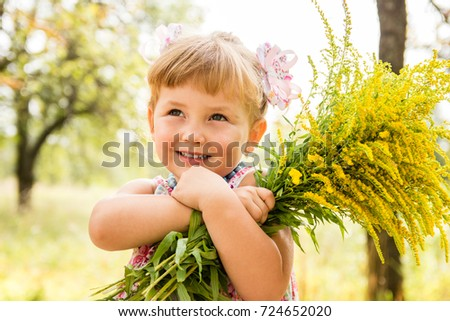 little blond girl with flowers