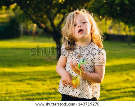 Little blond girl with funny expression - stock photo