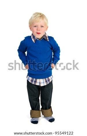 Little blond toddler laughing and standing in the studio