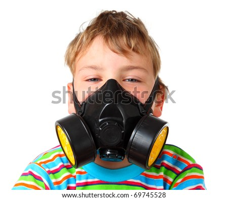 Little blonde boy screw up ones eyes in black respirator on a white background - stock photo