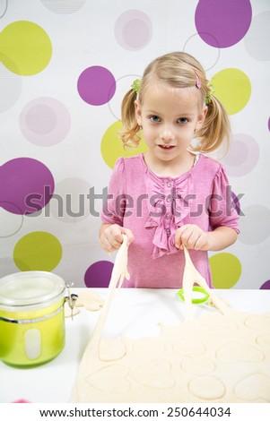 little blonde girl make cake - stock photo