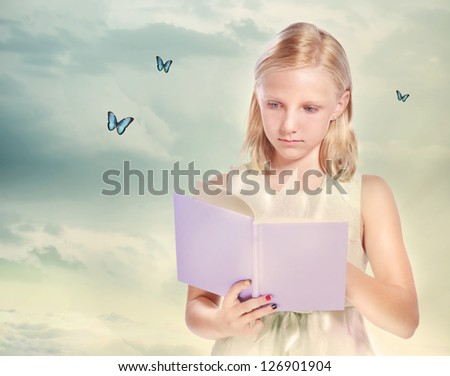 Little Blonde Girl Reading a Book with Butterflies - stock photo