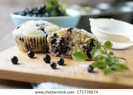 little blueberry cakes with fresh fruits - stock photo