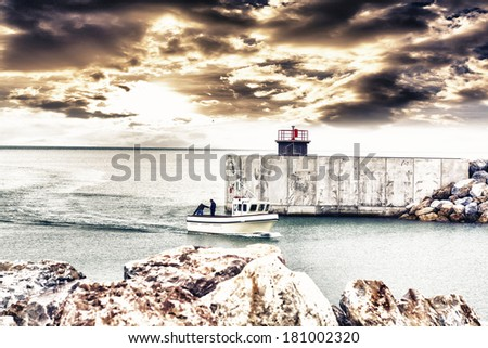 Little boat in the harbor. - stock photo