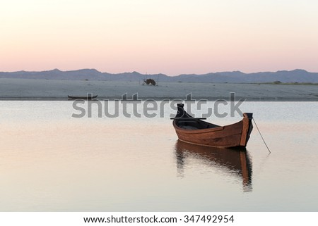 little boat on river at sunset