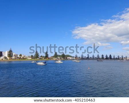 Little boats on blue sea at sunny day with cloud
