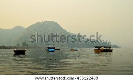 Little boats on Lake Begnas, Nepal - stock photo