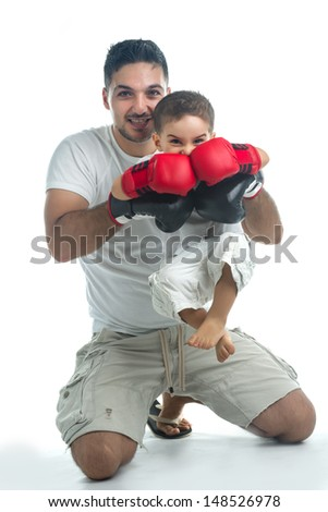 Little boxer getting help from his father - stock photo