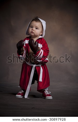 Little boxer in red robe - stock photo