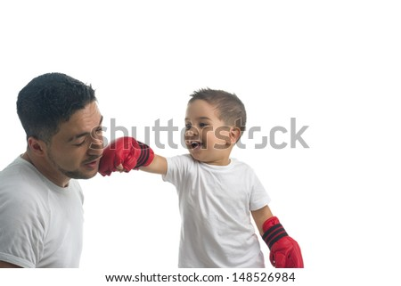 Little boxer punching his parent - stock photo
