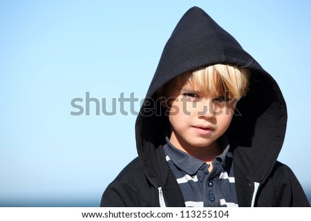 Little boy against a blue sky - stock photo