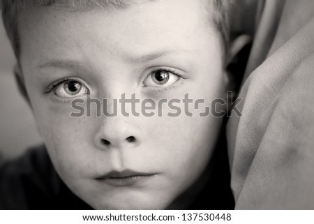 little boy alone with a look of fear - stock photo