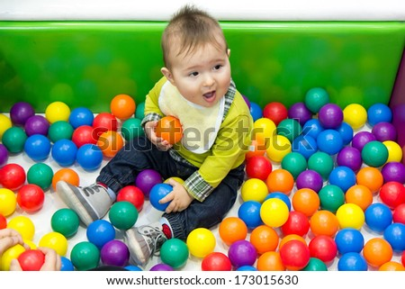 Little boy and balls - stock photo