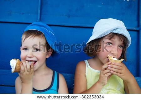 Little boy and girl eating ice cream - stock photo