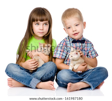 little boy and girl hugging kitten. isolated on white background - stock photo