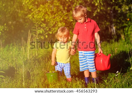 little boy and girl working in the garden