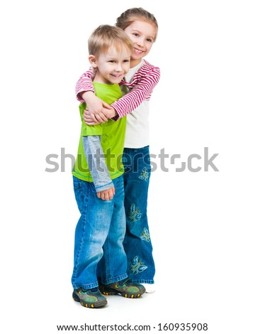 little boy and his cute sister isolated - stock photo