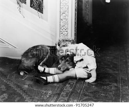 Little boy and his dog sleeping - stock photo