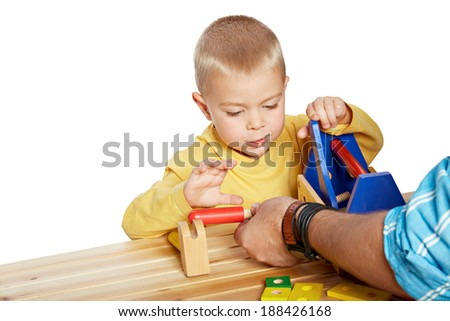 Little boy and his father playing with wooden eco friendly toys on isolated white background  - stock photo