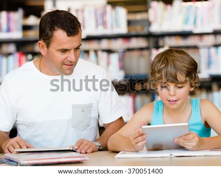 Little boy and his father with laptop - stock photo